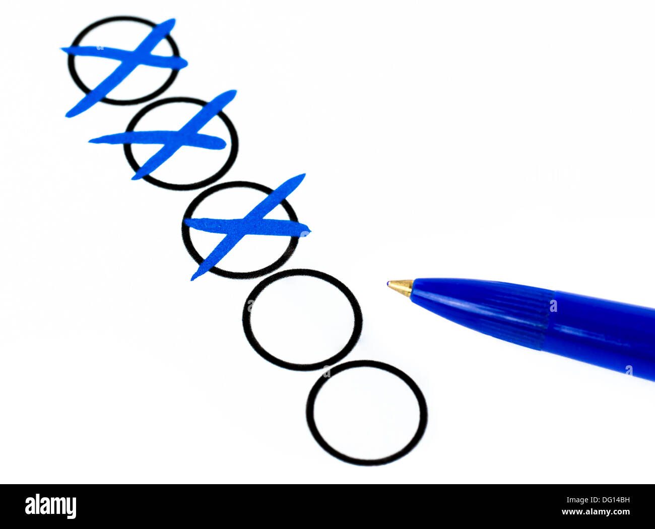 A blue pen is next to the checked boxes. - Stock Image