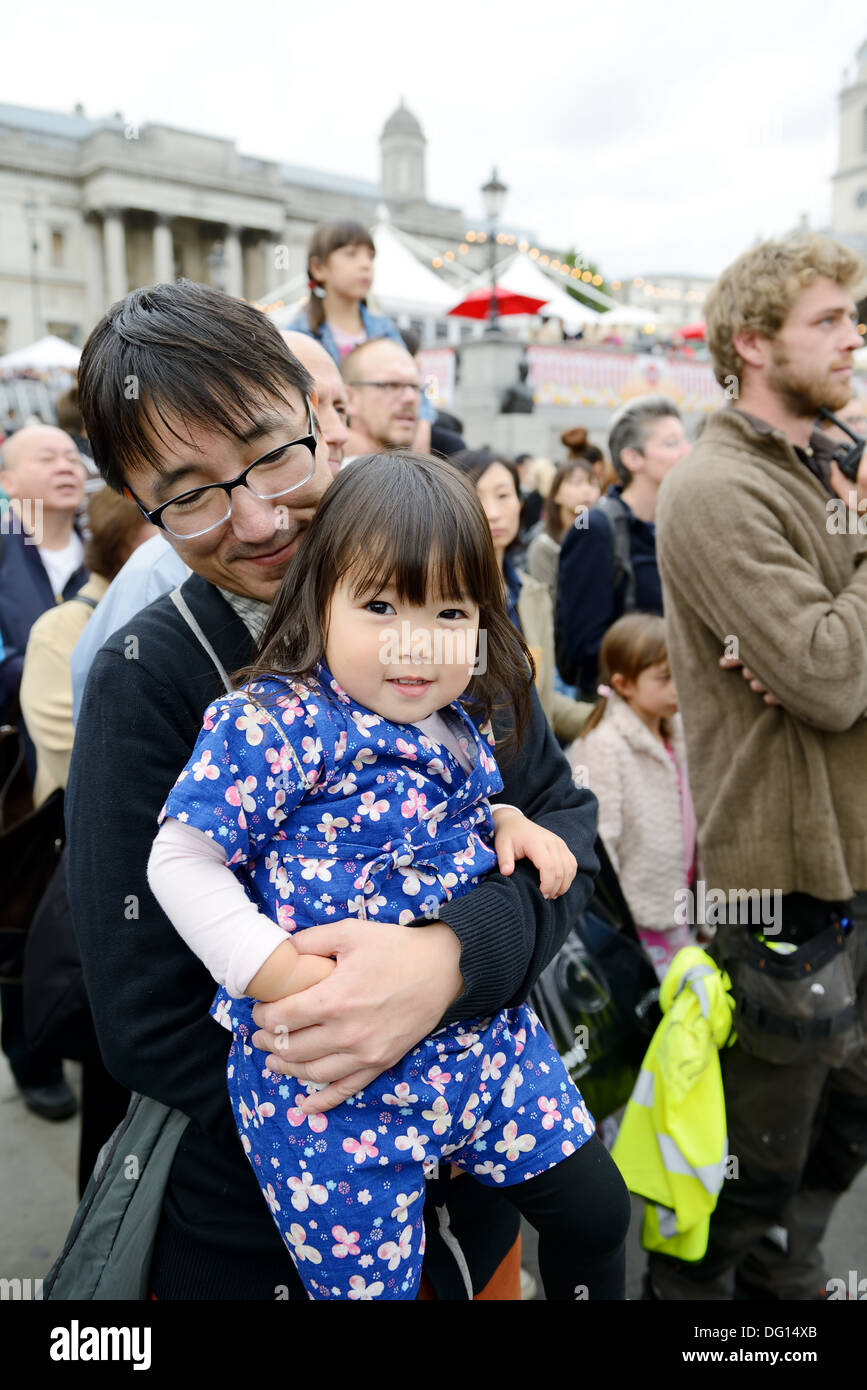 Young Japanese girl wearing traditional costume of kimono at matsuri  festival in London England. Oct