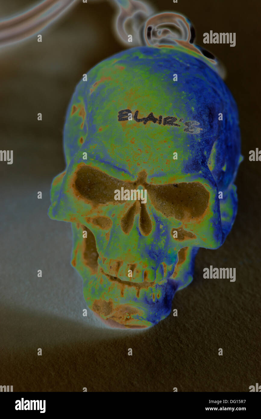 Old Blair's skull keyring solarization - Stock Image
