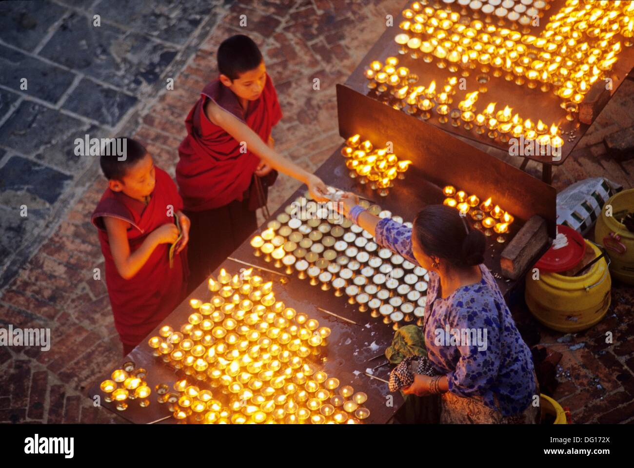 light offerings at Bodnath Temple,Nepal,Himalaya,South Asia - Stock Image