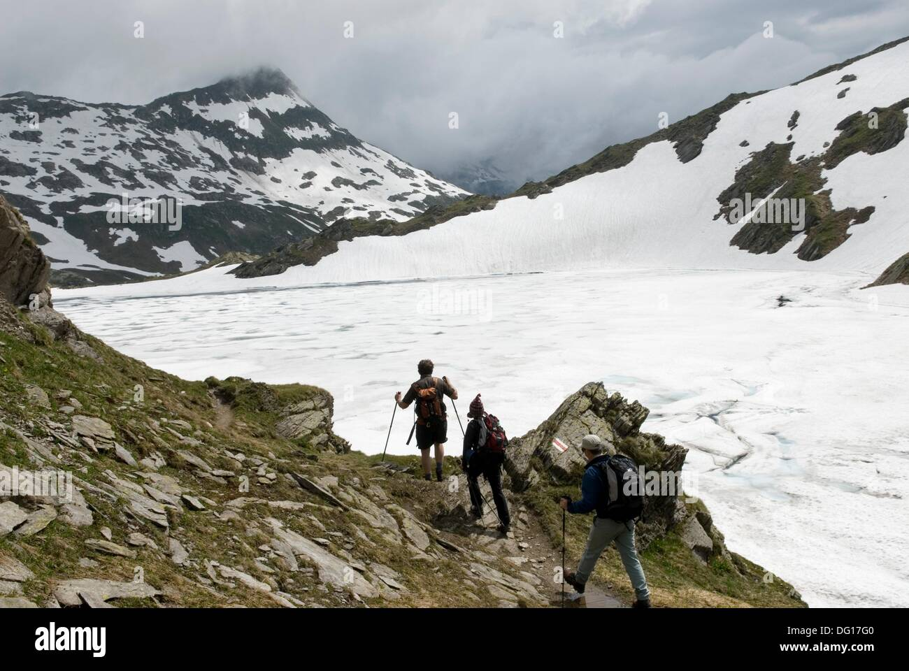 trekkers by the Scuro lake, Val Piora, Canton Ticino, Switzerland, Europe - Stock Image