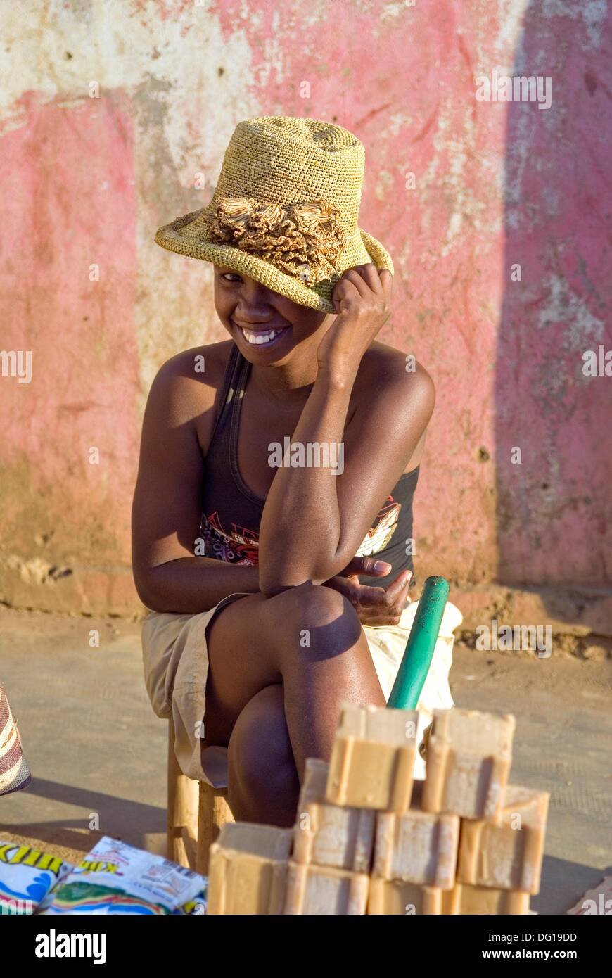 young street seller girl, Hell-Ville Andoany, Nosy Be island, Republic of Madagascar, Indian Ocean - Stock Image