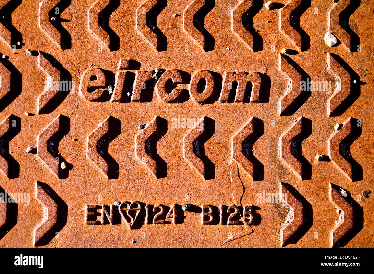 Eircom logo on rusting steel iron access cover - Stock Image