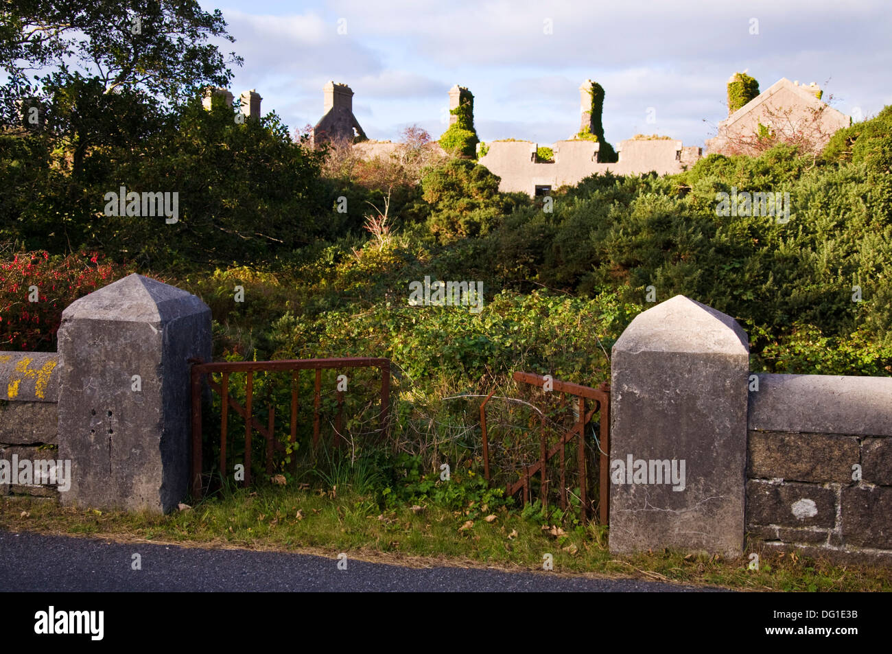 Rusting gate to old British army barracks now a ruin since war of Independence at Burtonport County Donegal Ulster Ireland - Stock Image