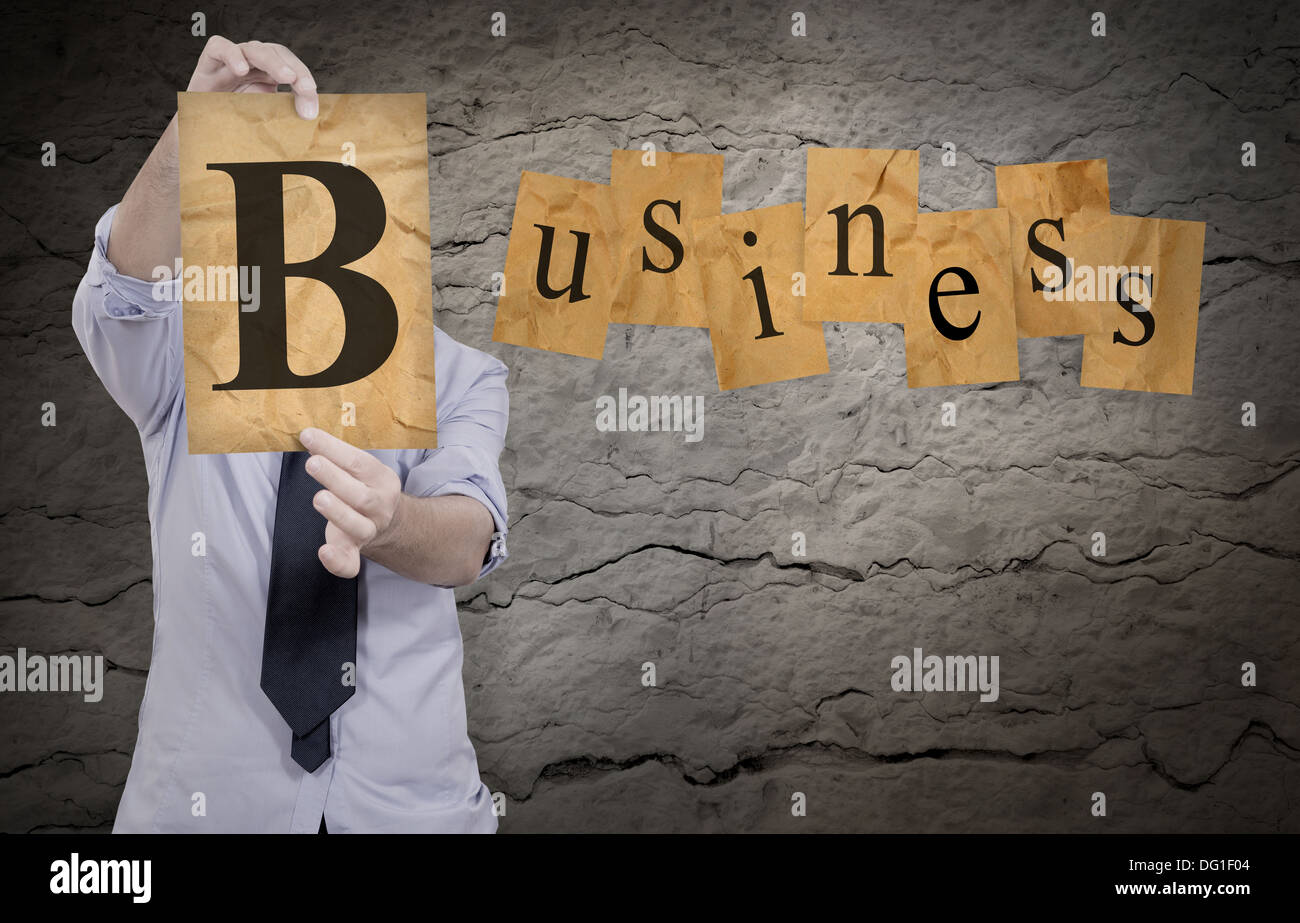 businessman show b letter to complete word business - Stock Image