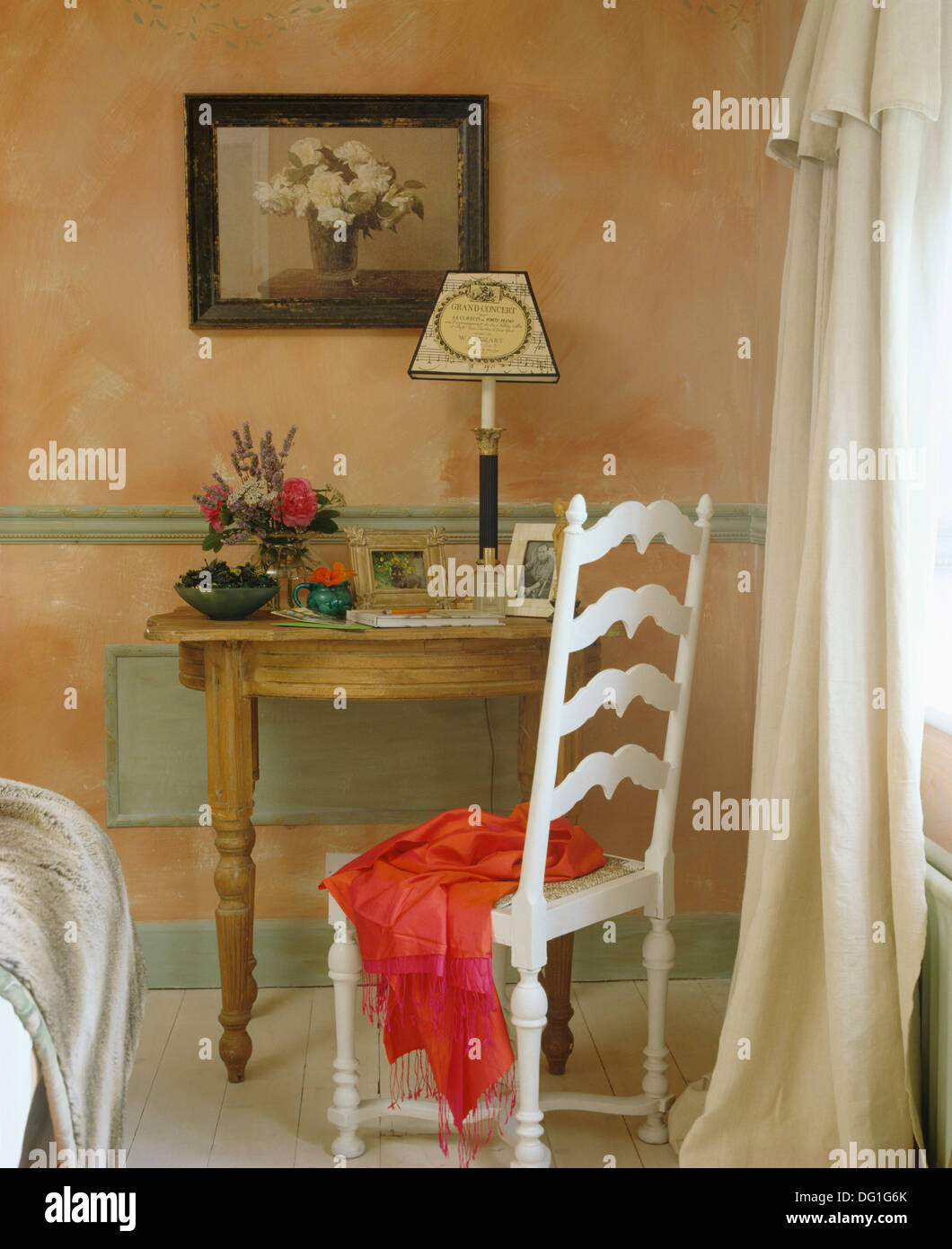 Pink Stole On White Painted Ladder Back Chair At Small Pine Table In  Cottage Living Room With Sponge Effect Painted Walls