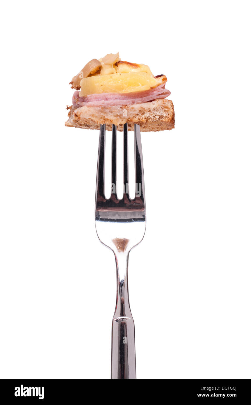 Hawai Toast with pineapple, ham and mushrooms on a fork - Stock Image