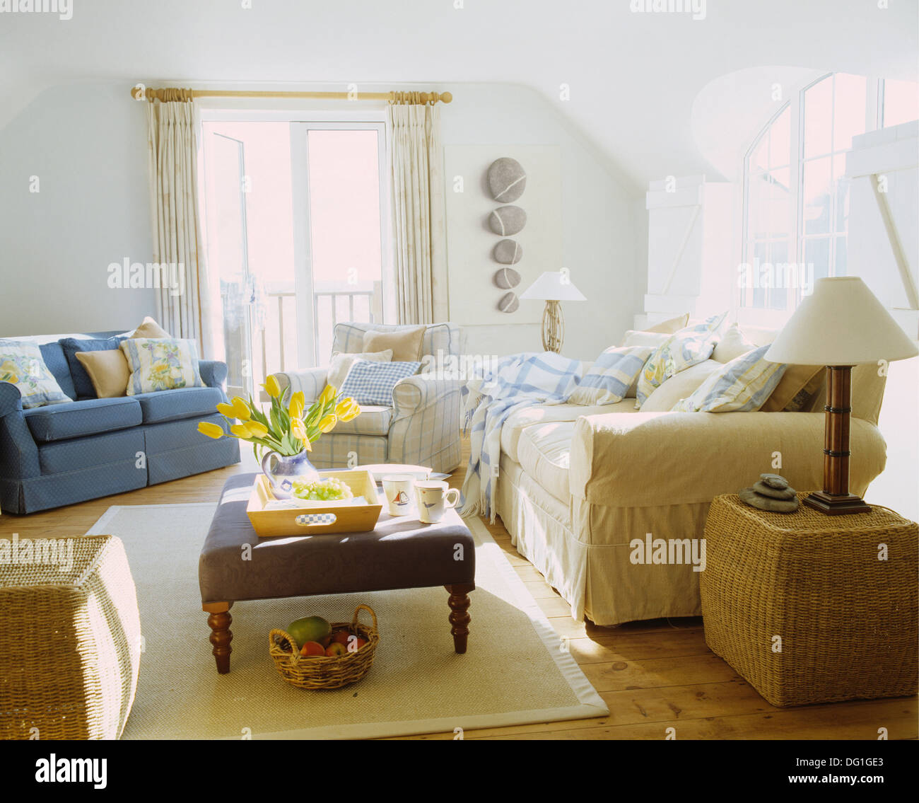 Wicker Cube Tables And Blue And Cream Sofas In White Coastal Living Stock Photo Alamy