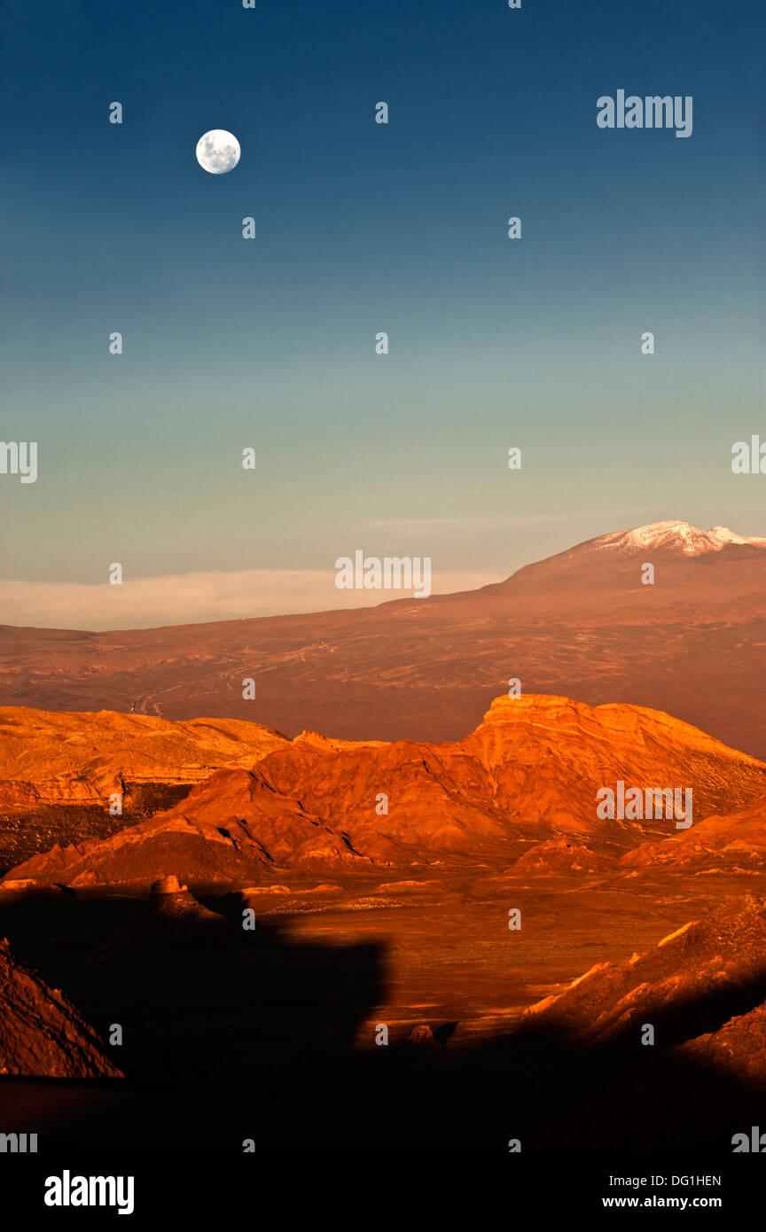 Moon Valley. Volcanoes Licancabur and Juriques,  Atacama, Chile - Stock Image
