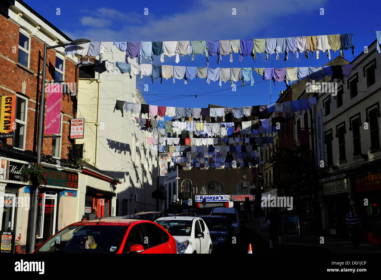 Derry, Londonderry, Northern Ireland, UK. 11th Oct, 2013. Belfast artist Rita Duffy celebrates Londonderry's shirt manufacturing history with a display of over 300 shirts hanging across William Street. The eye-catching art installation is an aspect of the artist's Shirt Factory project and part of the UK City of Culture celebrations. .  Credit: George Sweeney / Alamy Live News - Stock Image
