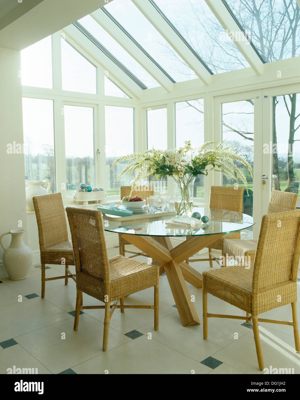 High Back Wicker Chairs And Glass Table In Modern