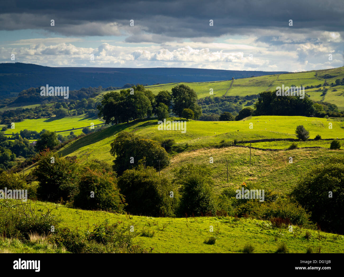 View across countryside near Eyam village in the Peak District National Park Derbyshire England UK with stormy sky above - Stock Image