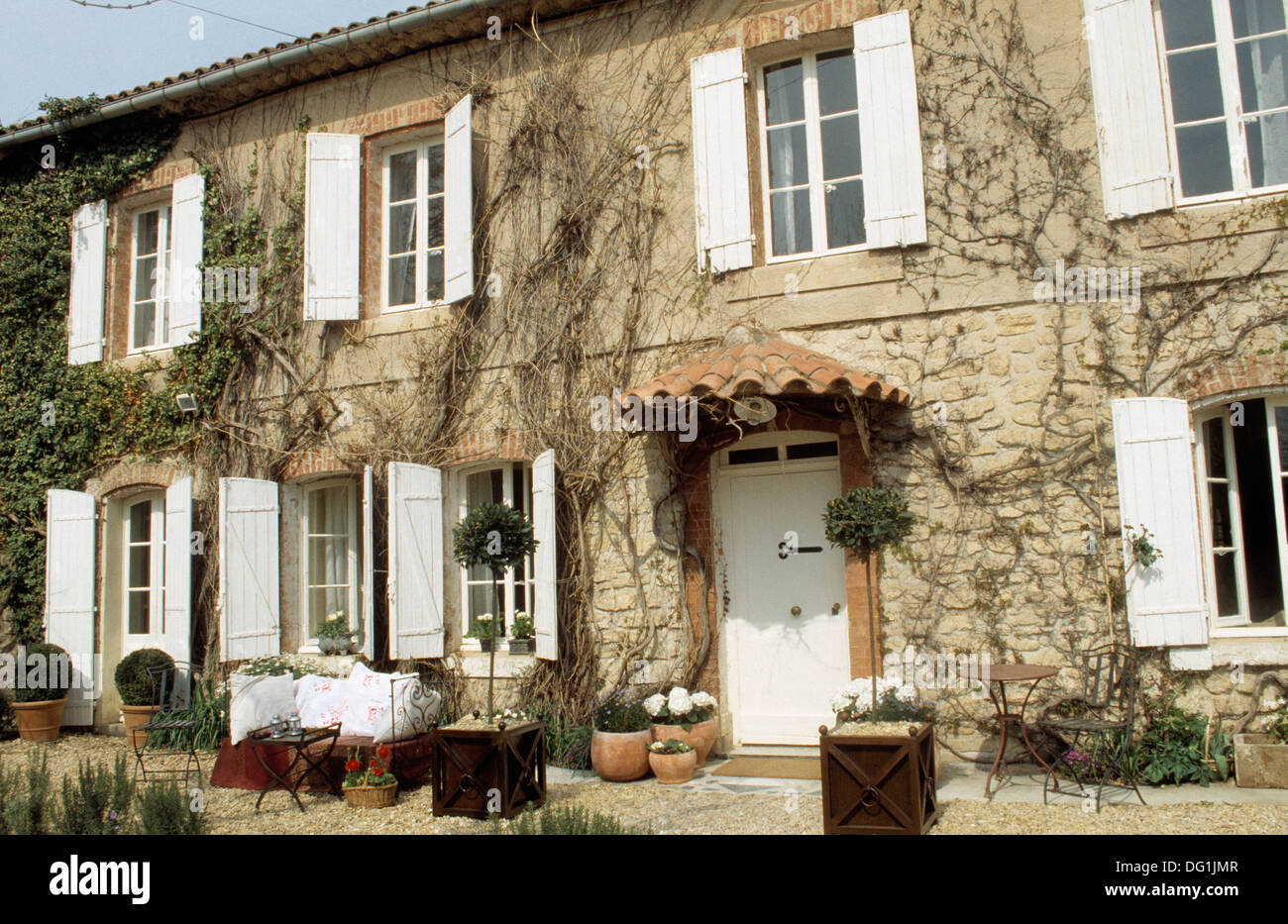 Traditional French Country House With White Shutters On The Windows