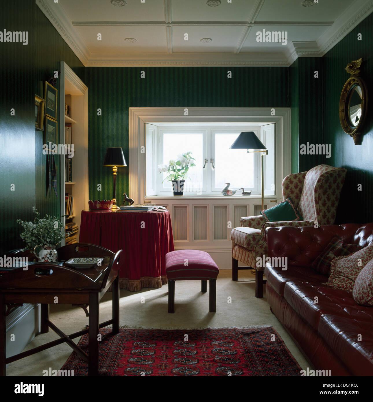 Wing Chair And Brown Leather Sofa In Dark Green Living Room With Stock Photo 61502784 Alamy