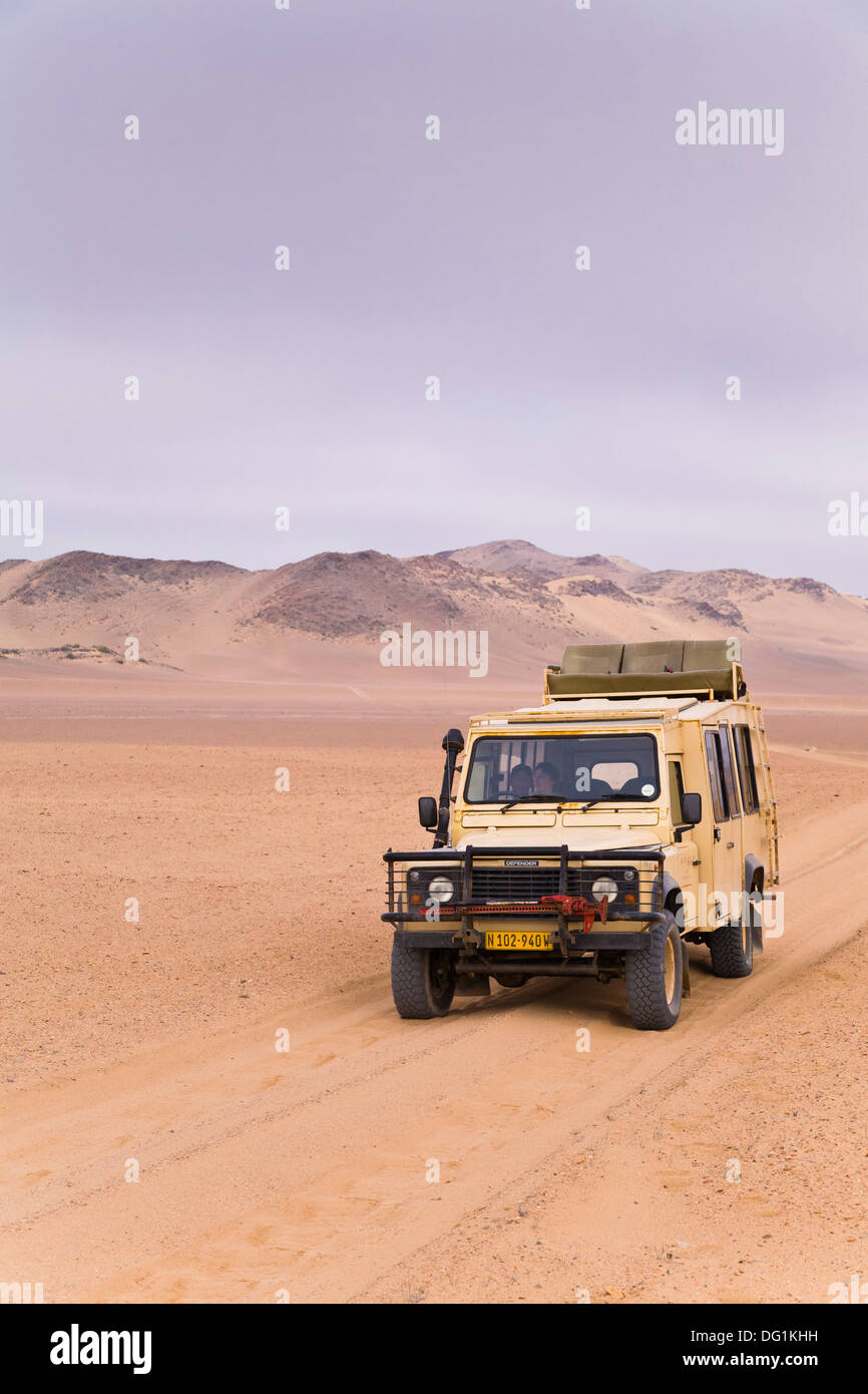 A landrover driving through the isolate Skeleton Coast Park, Namibia, Africa - Stock Image