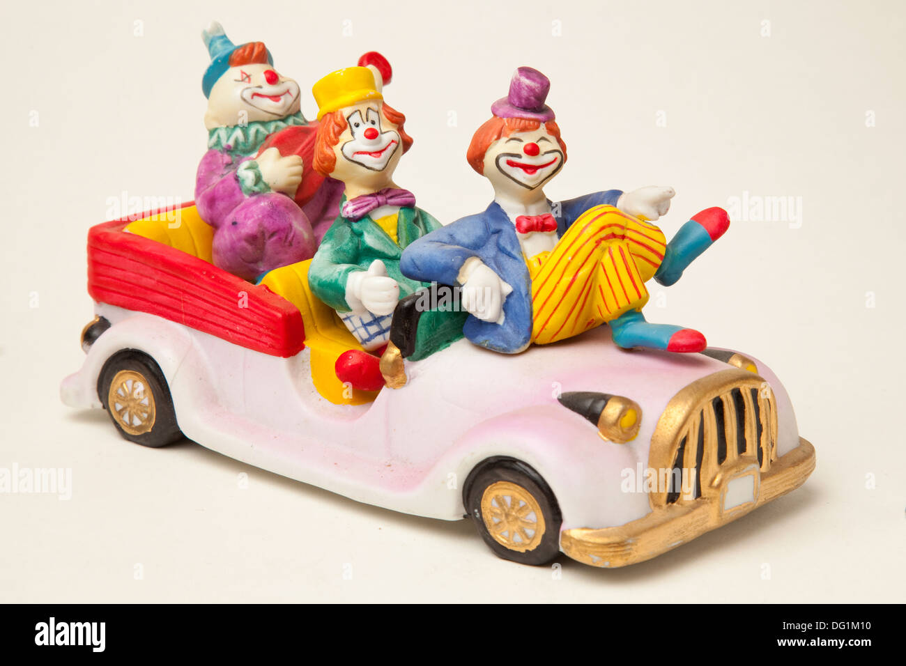 Clowns in a pink car - Stock Image