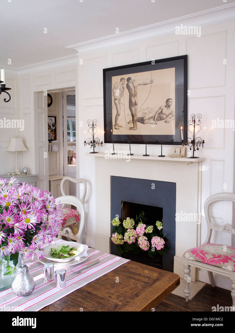 Picture Above Fireplace With Pink Hydrangeas In White Dining Room With Pink  Daisies And Striped Cloth On The Table
