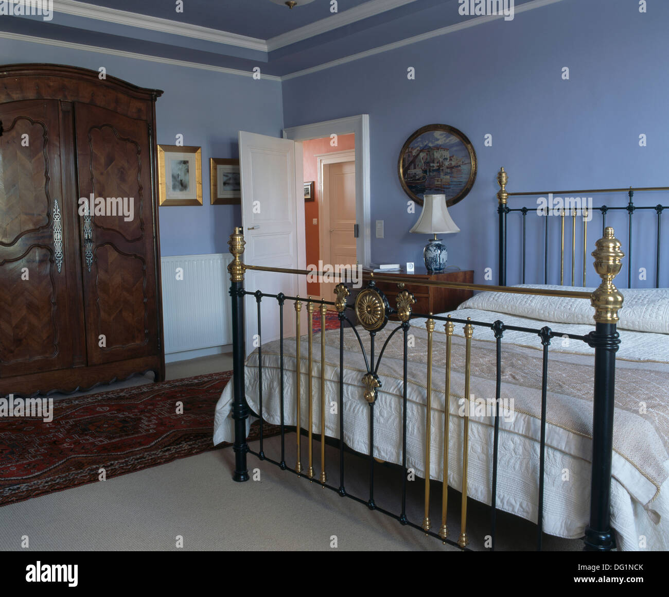 Antique Brass Bed In Pale Blue French Country Bedroom With Oak Wardrobe