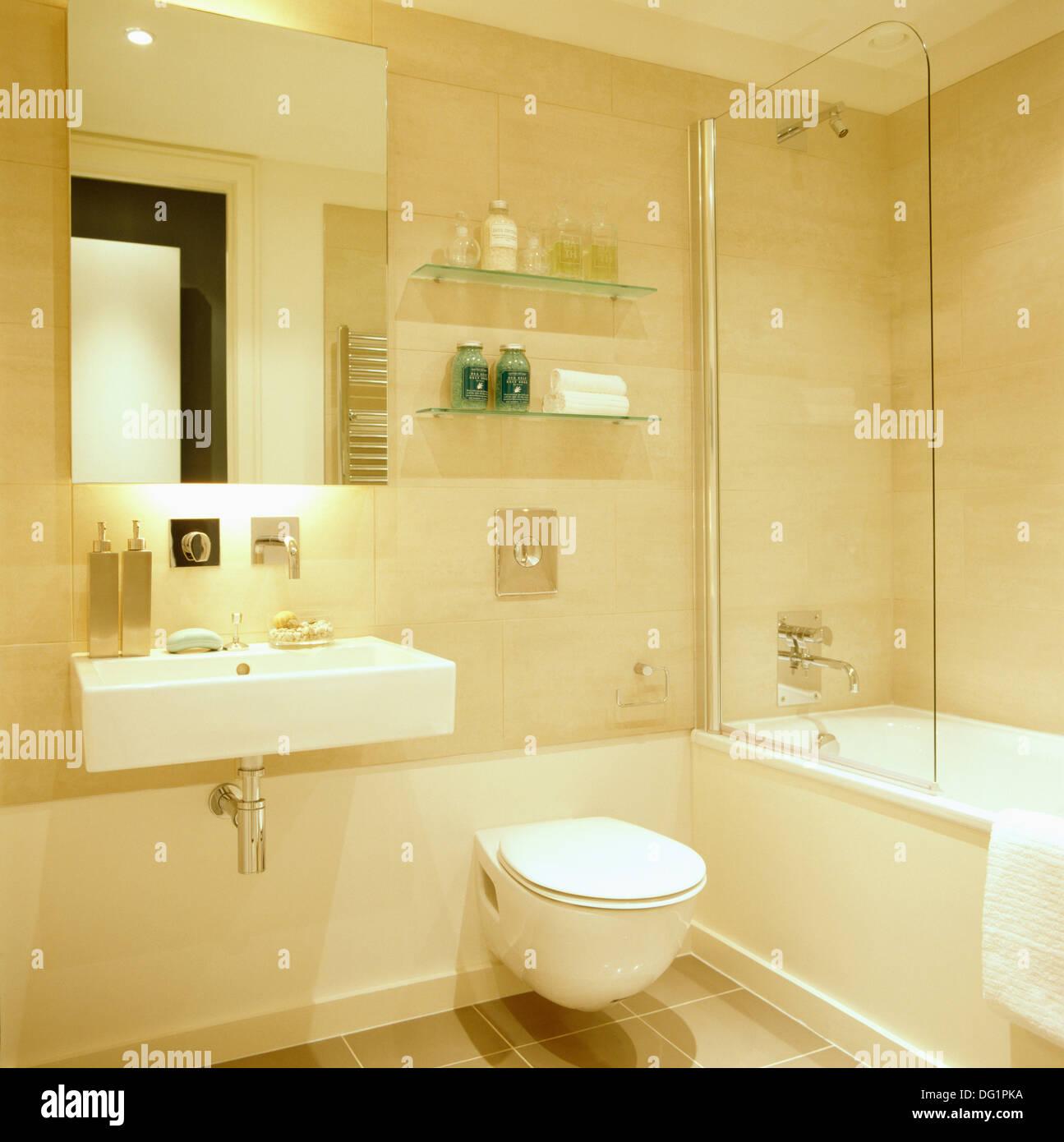 Mirror above rectangular basin in modern city bathroom with toilet ...