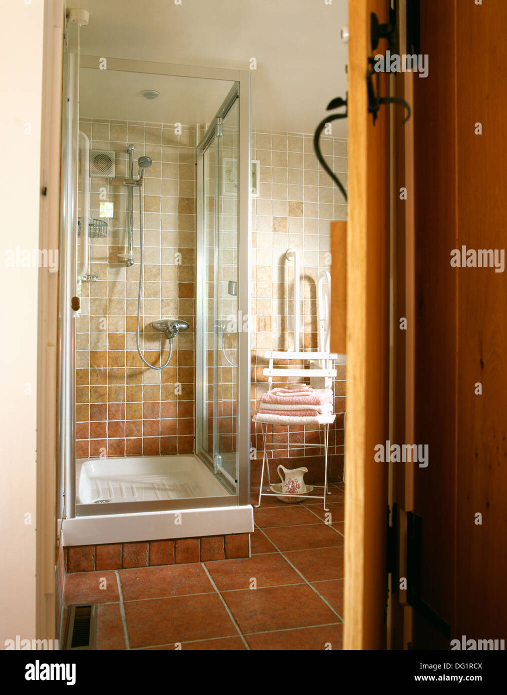 Door open to cottage bathroom with glass shower cabinet and quarry ...