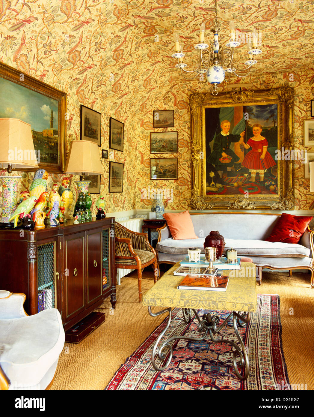 Richly patterned wallpaper on walls and ceiling in old-fashioned ...