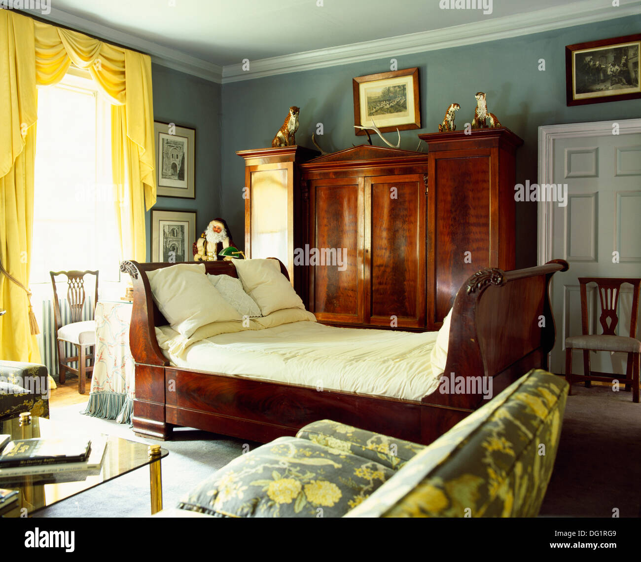 - White Bedlinen On Antique Sleigh Bed In Green-blue Bedroom With