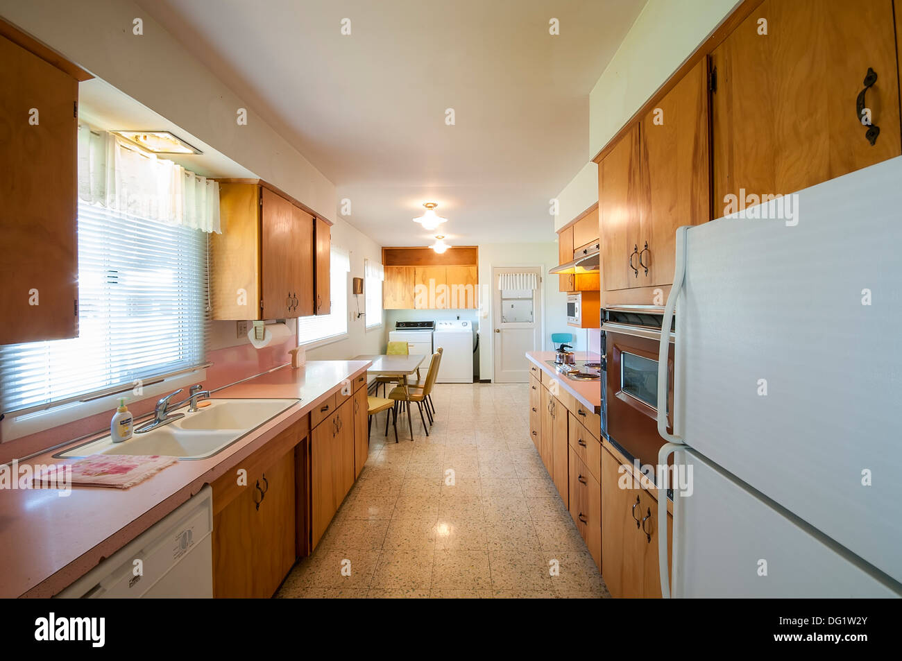 Kitchen in house built around 1959, with very little remodeling.  Very retro.  Cozy and warm. - Stock Image