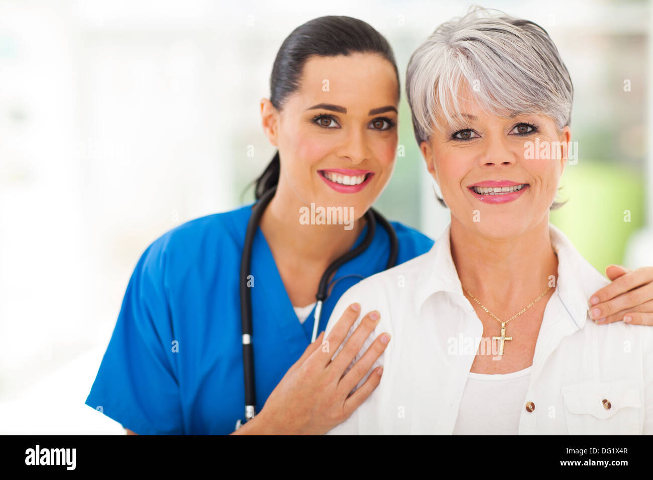 portrait of middle aged woman and medical nurse Stock Photo