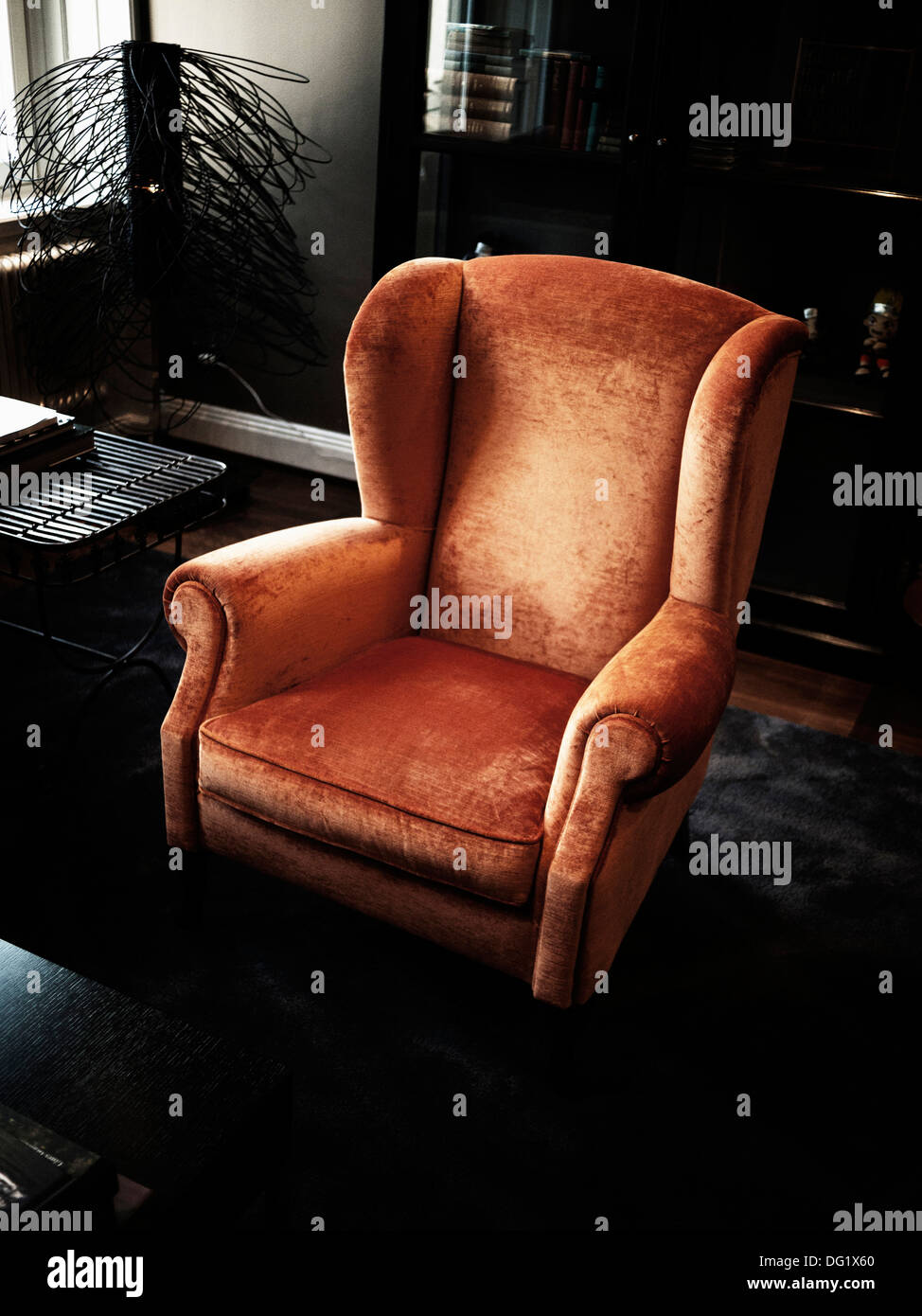 Upholstered Wing Chair in Living Room - Stock Image