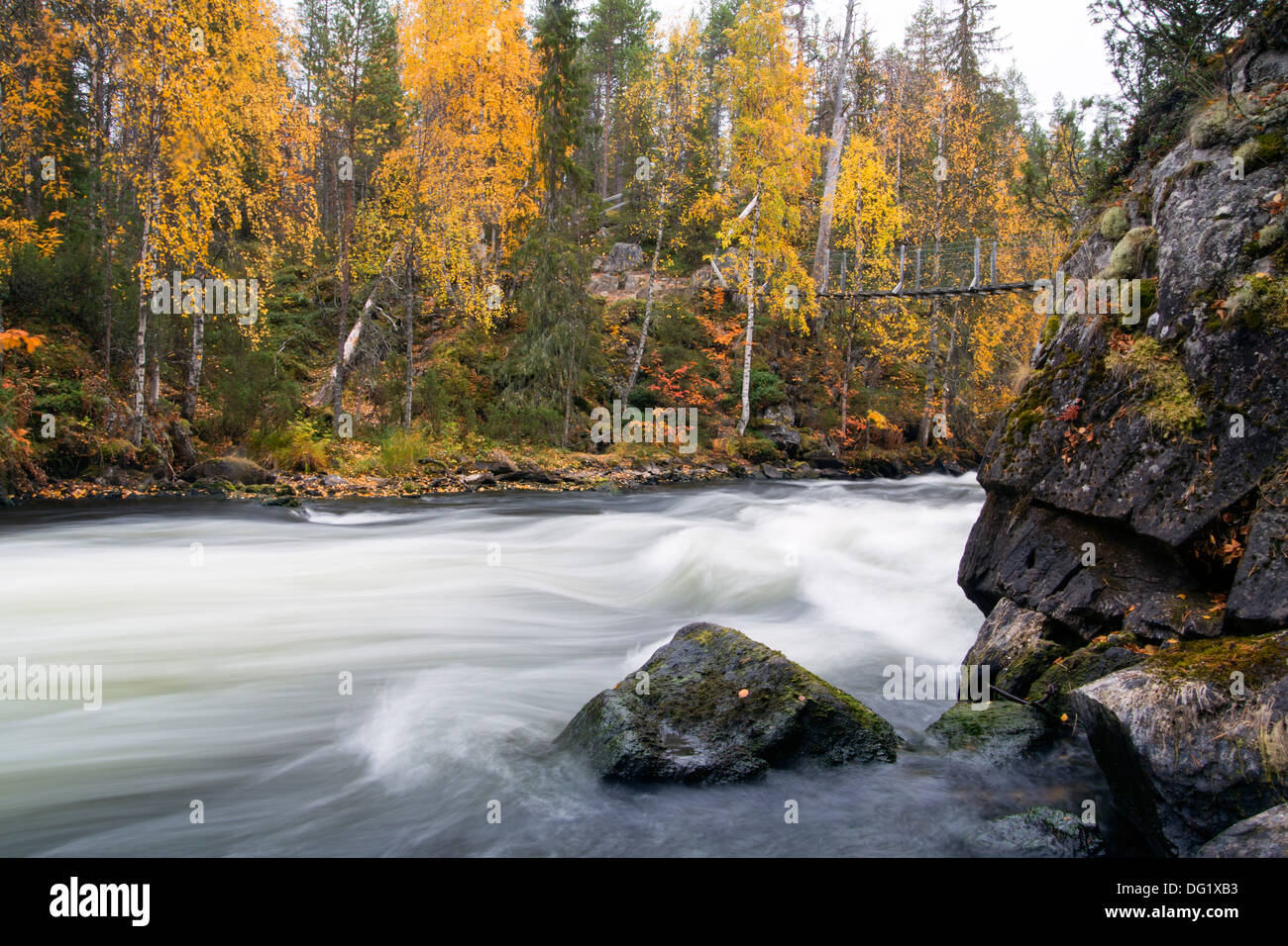Fast flowing river flow over rocky sturdy coast - Stock Image