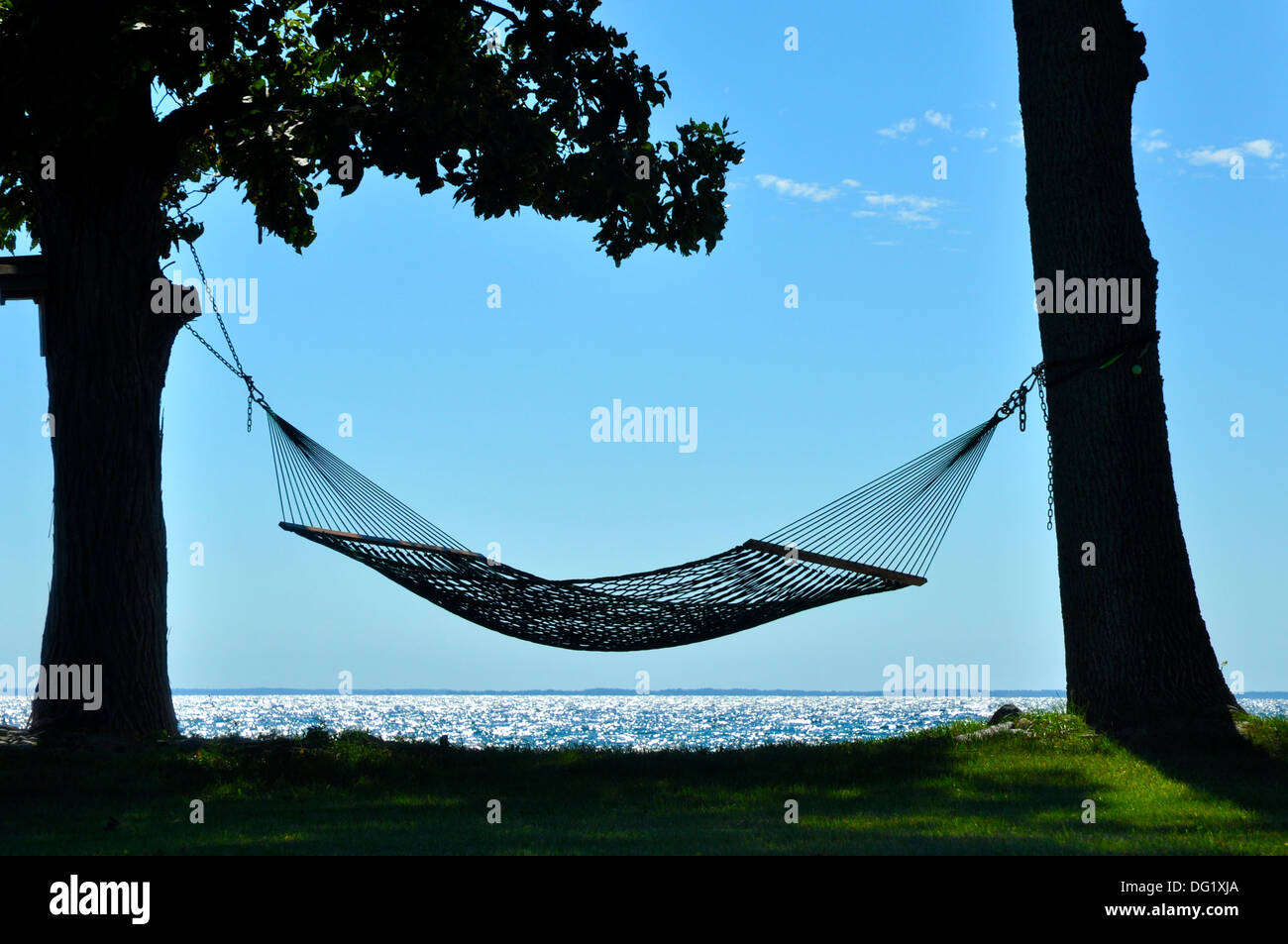 hammock between two trees on shoreline of Lake Ontario New York - Stock Image