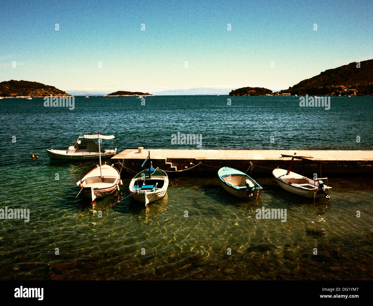 Small Boats Moored to Dock - Stock Image