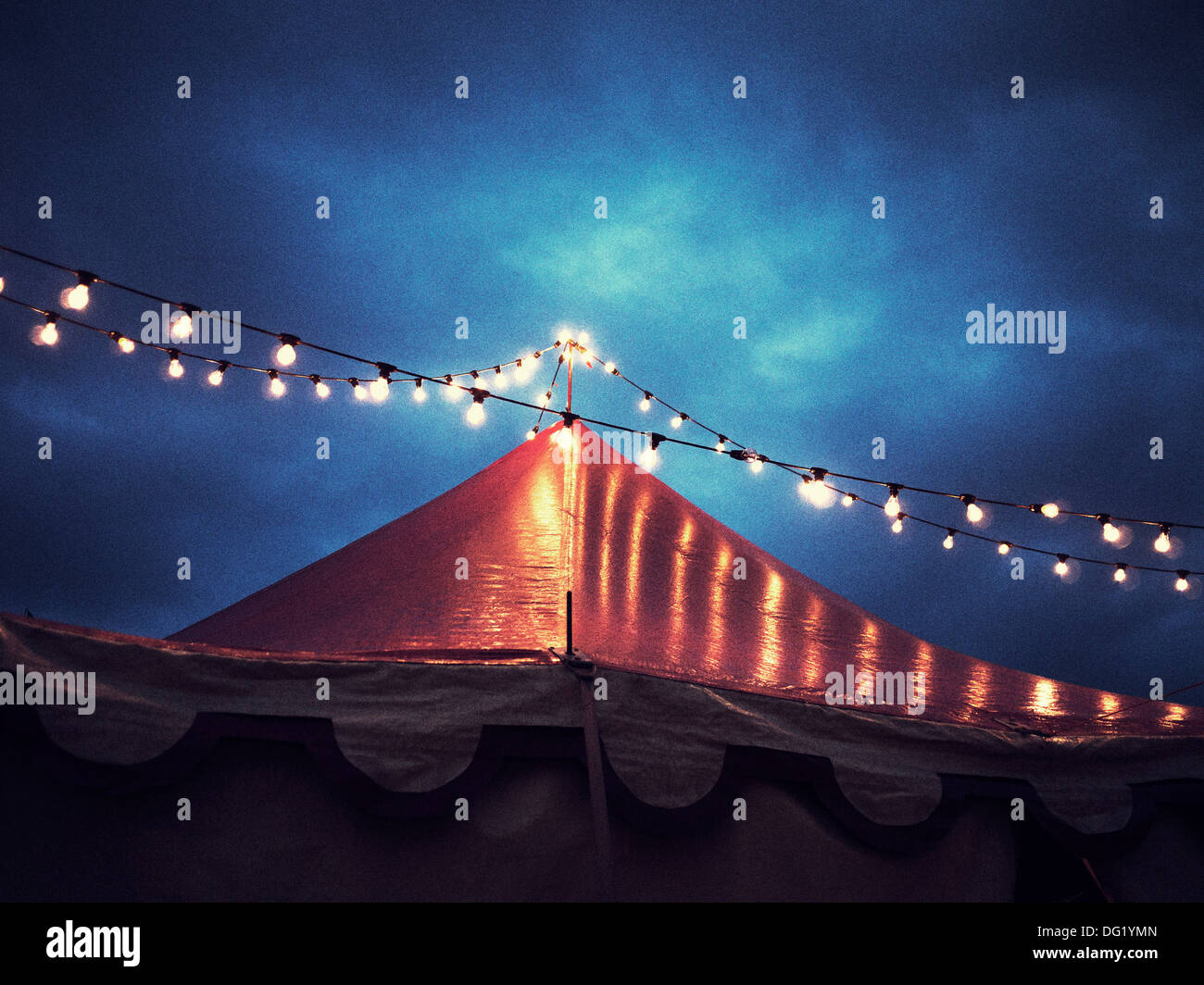 Circus Tent and String of Lights at Night, Low Angle View - Stock Image