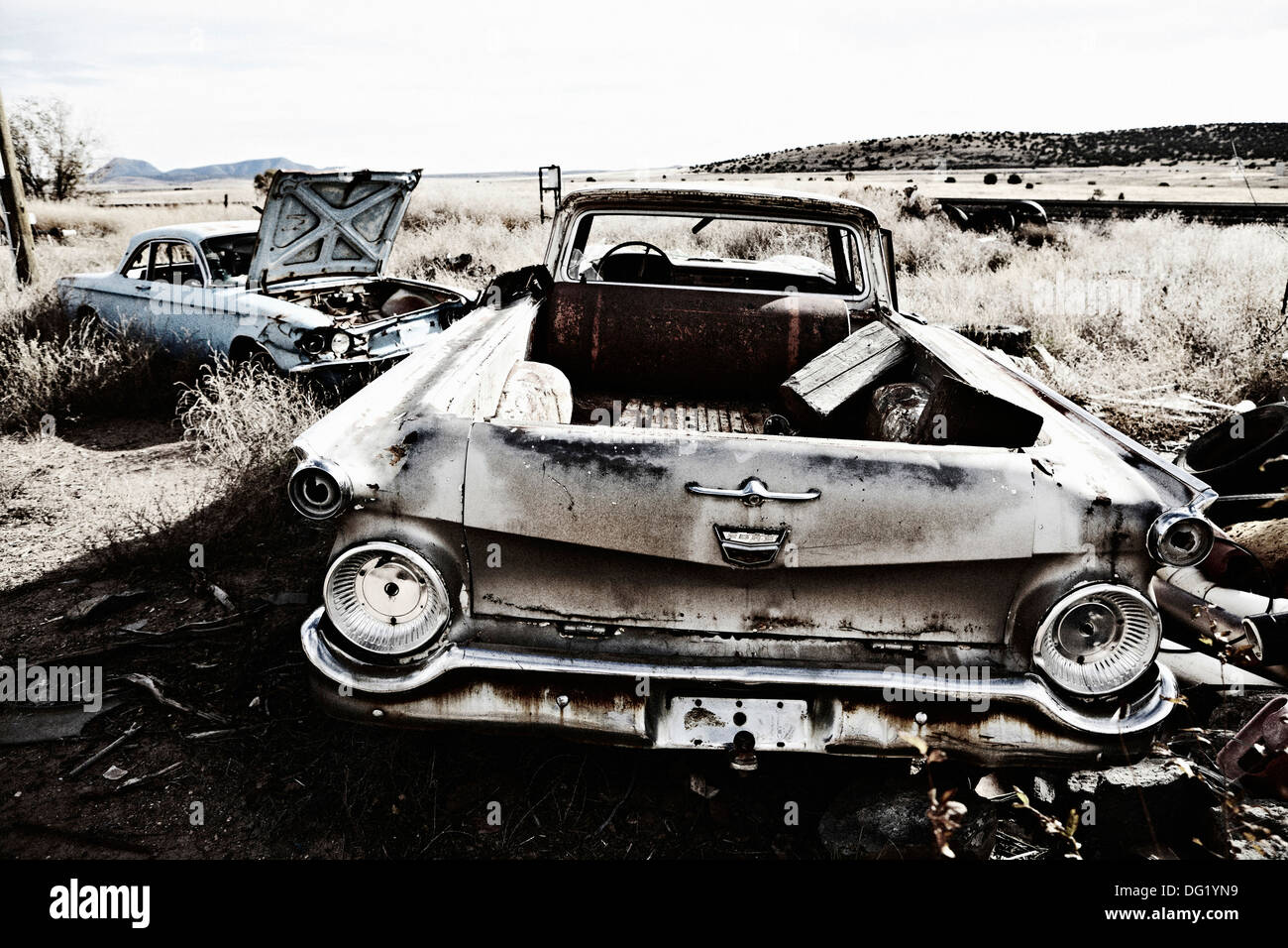 Two Old Abandoned Cars in Desert - Stock Image
