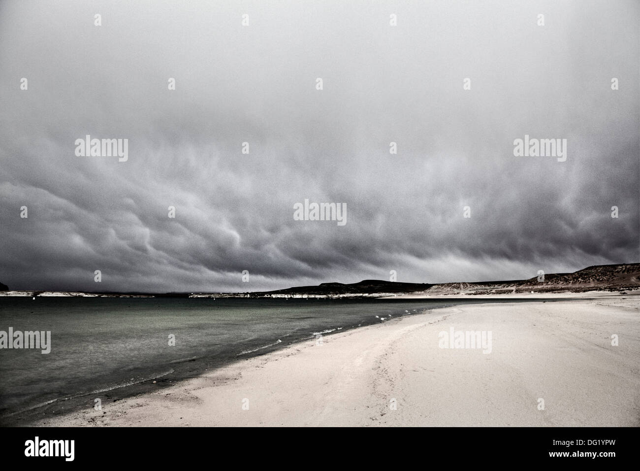 Ominous Gray Clouds Over Sandy Beach, Utah, USA - Stock Image