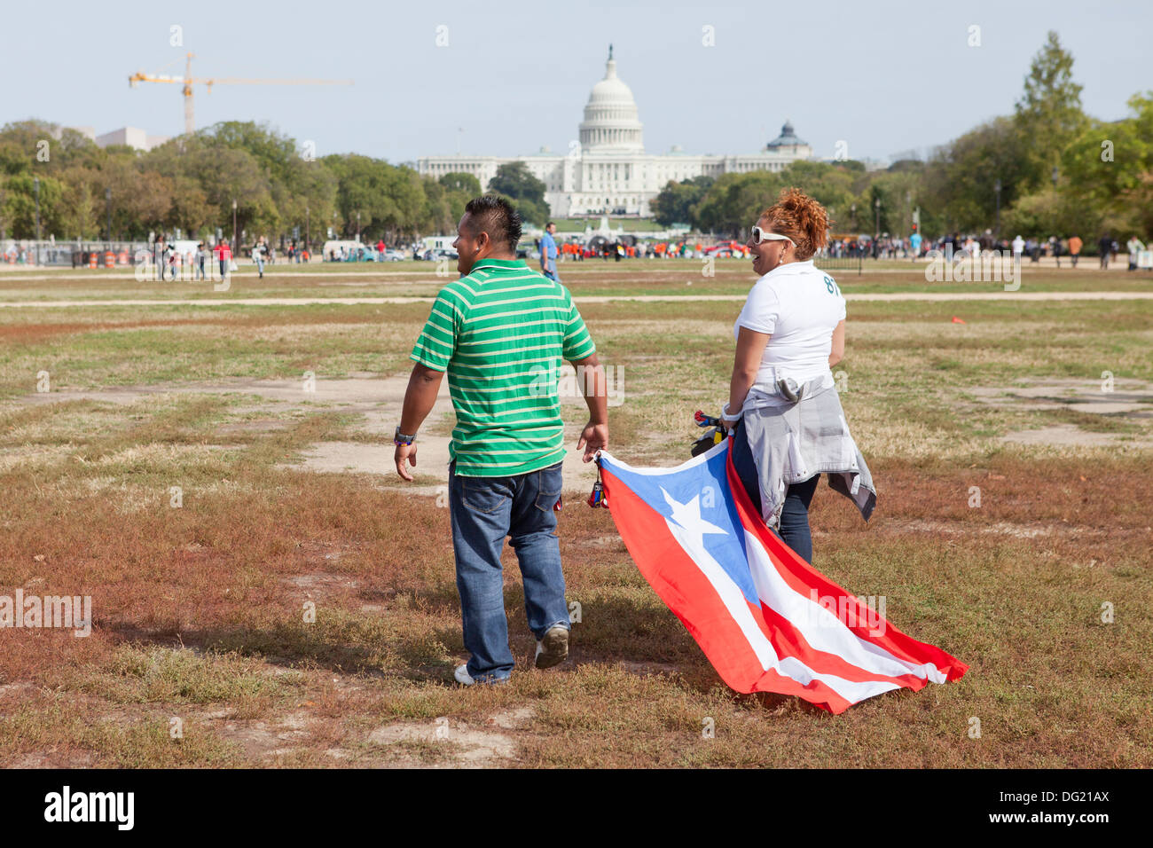 Couple walking with Puerto Rican flag at Immigration Reform rally - Washington, DC USA - Stock Image