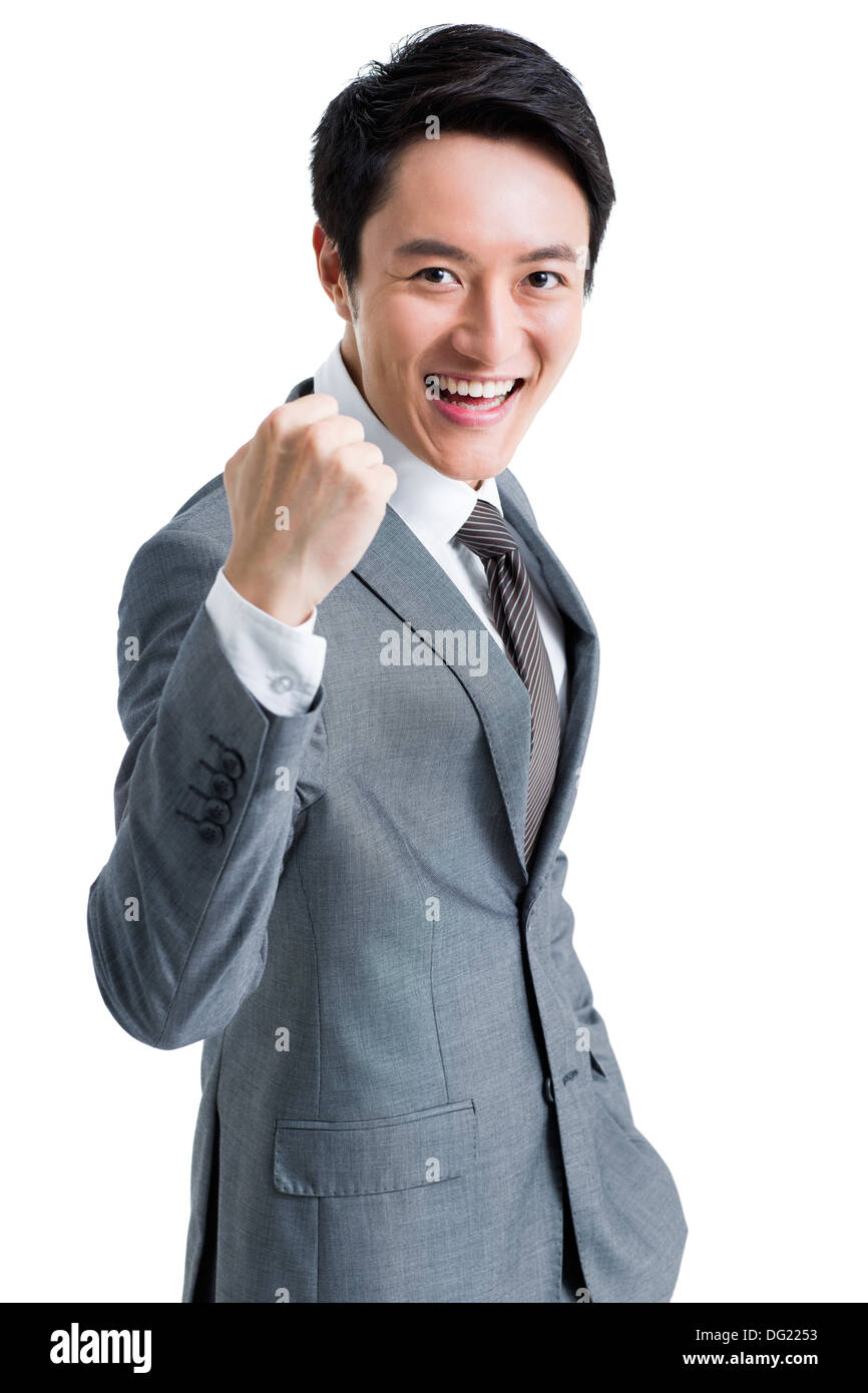 Excited businessman punching the air Stock Photo