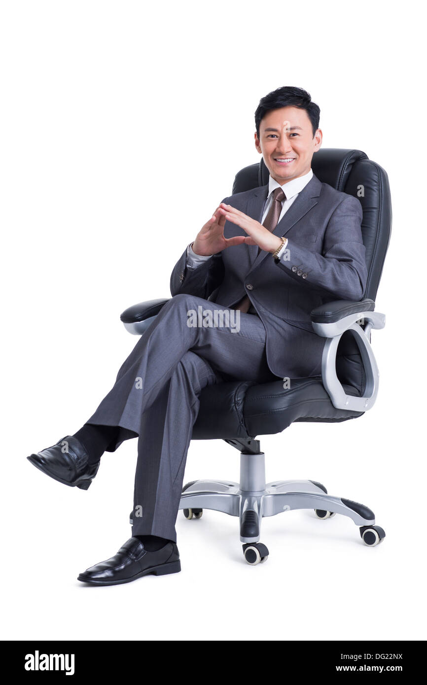 Mature manager sitting in chair - Stock Image