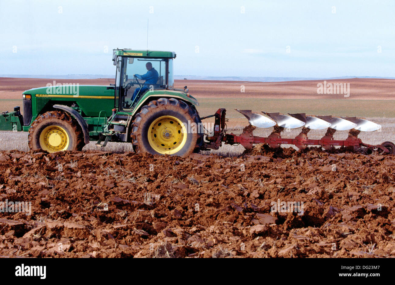 Tractor dragging a plough - Stock Image