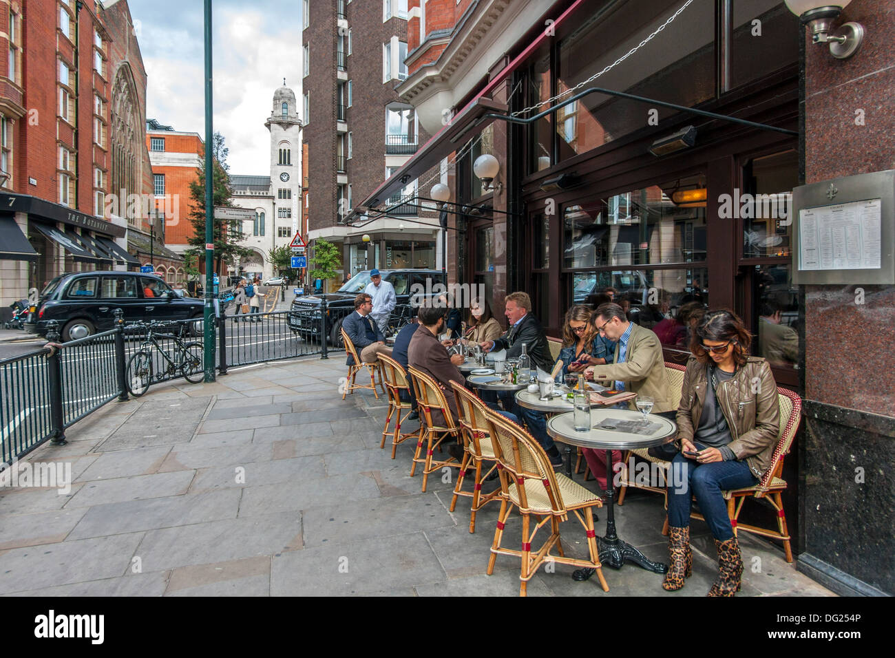Colbert Restaurant exterior with diners - Stock Image