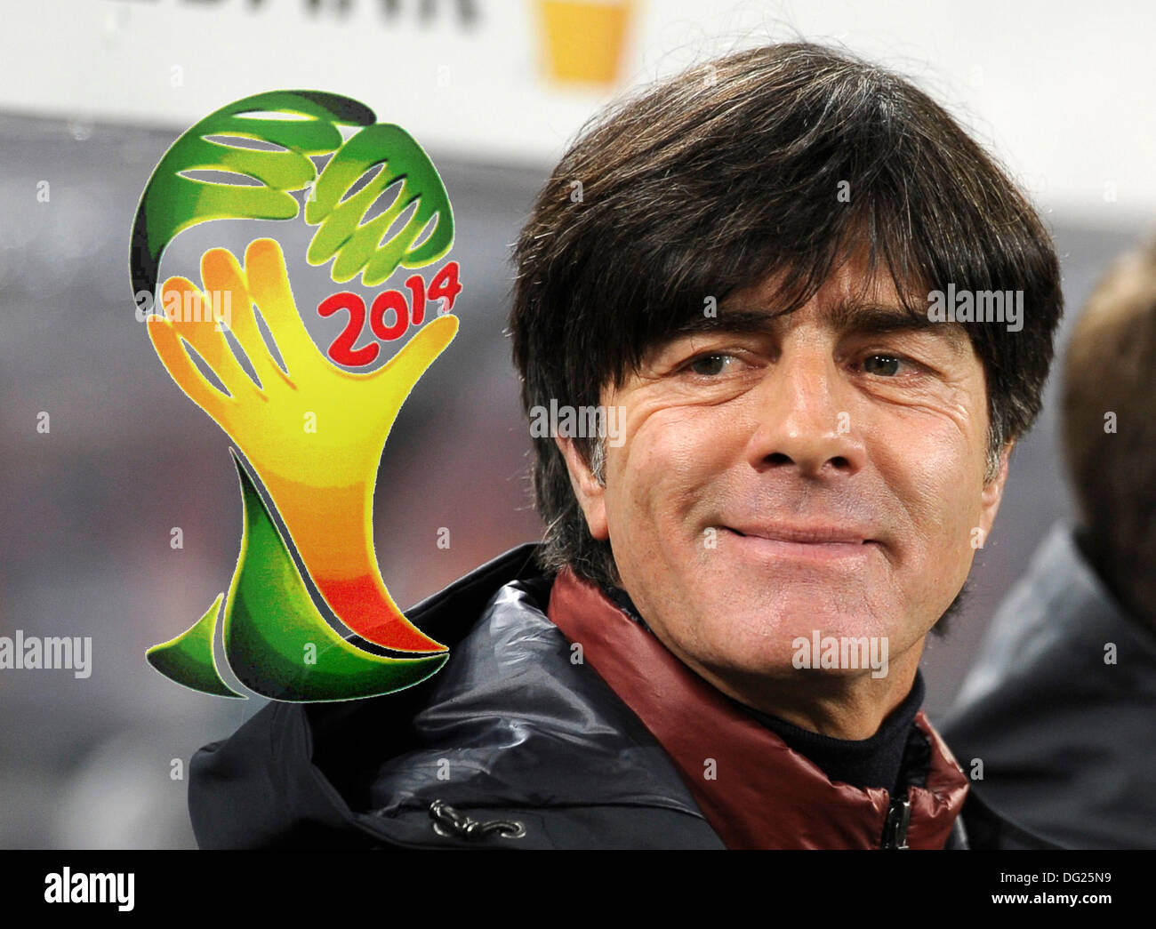Cologne, Germany. 11th Oct, 2013. Qualifying match for  FIFA Football World Cup 2014 Brasil in RheinEnergie stadium, Germany vs Republic of Ireland 3:0 -- Germany's national manager Joachim Jogi Lšw (Loew) smiles at the Logo of Brasil 2014 -- digitally altered photo-- © kolvenbach/Alamy Live News - Stock Image