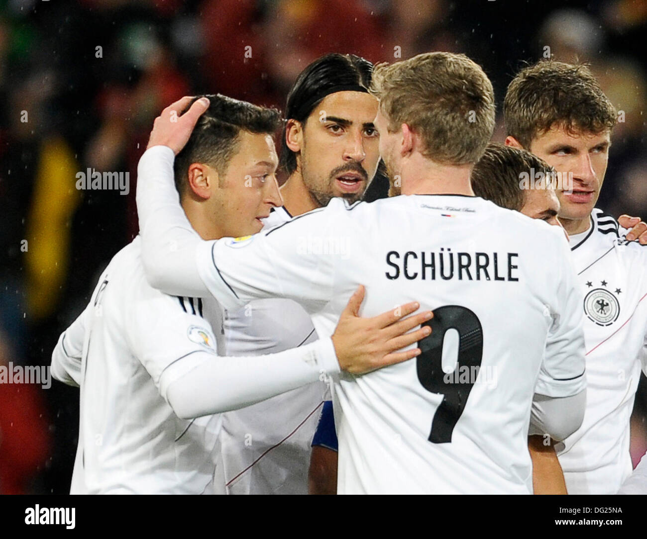 Cologne, Germany. 11th Oct, 2013. Qualifying match for  FIFA Football World Cup 2014 Brasil in RheinEnergie stadium, Germany vs Republic of Ireland 3:0 -- Germany's goal scorers Mesut …zil (Oezil, GER), Sami Khedira (GER) and Andre SchŸrrle (Schuerrle, GER), from left celebrate © kolvenbach/Alamy Live News - Stock Image