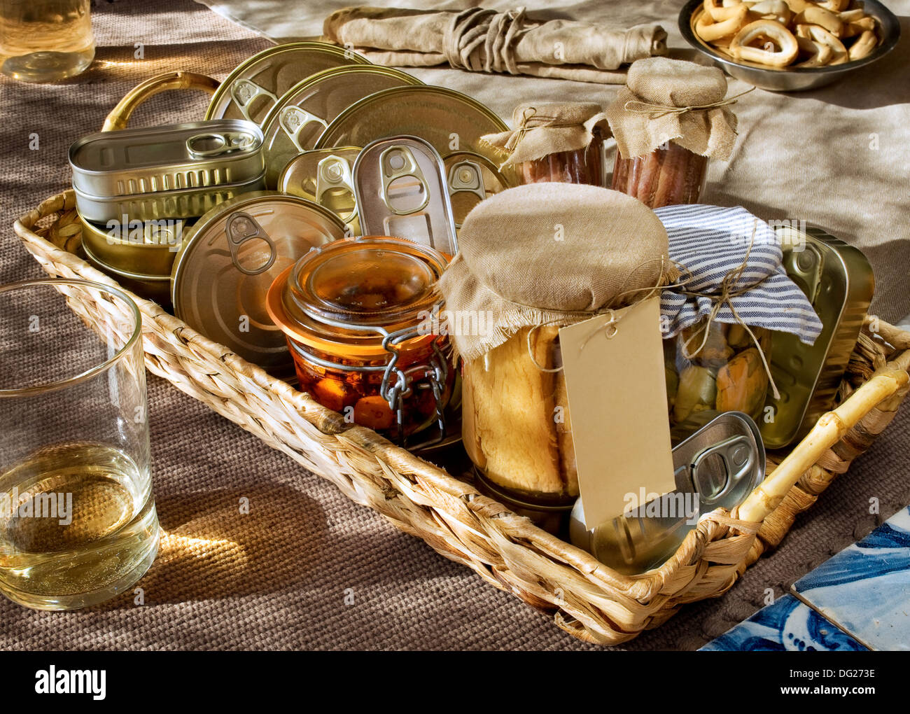 Fish cans and tuna, octopus, anchovies, mussels canned in glass - Stock Image