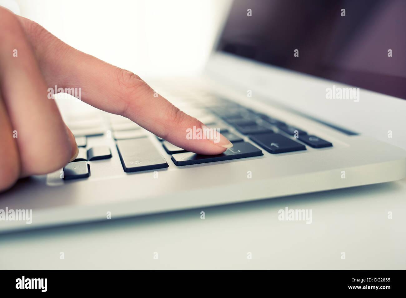 woman laptop finger indoor desk - Stock Image