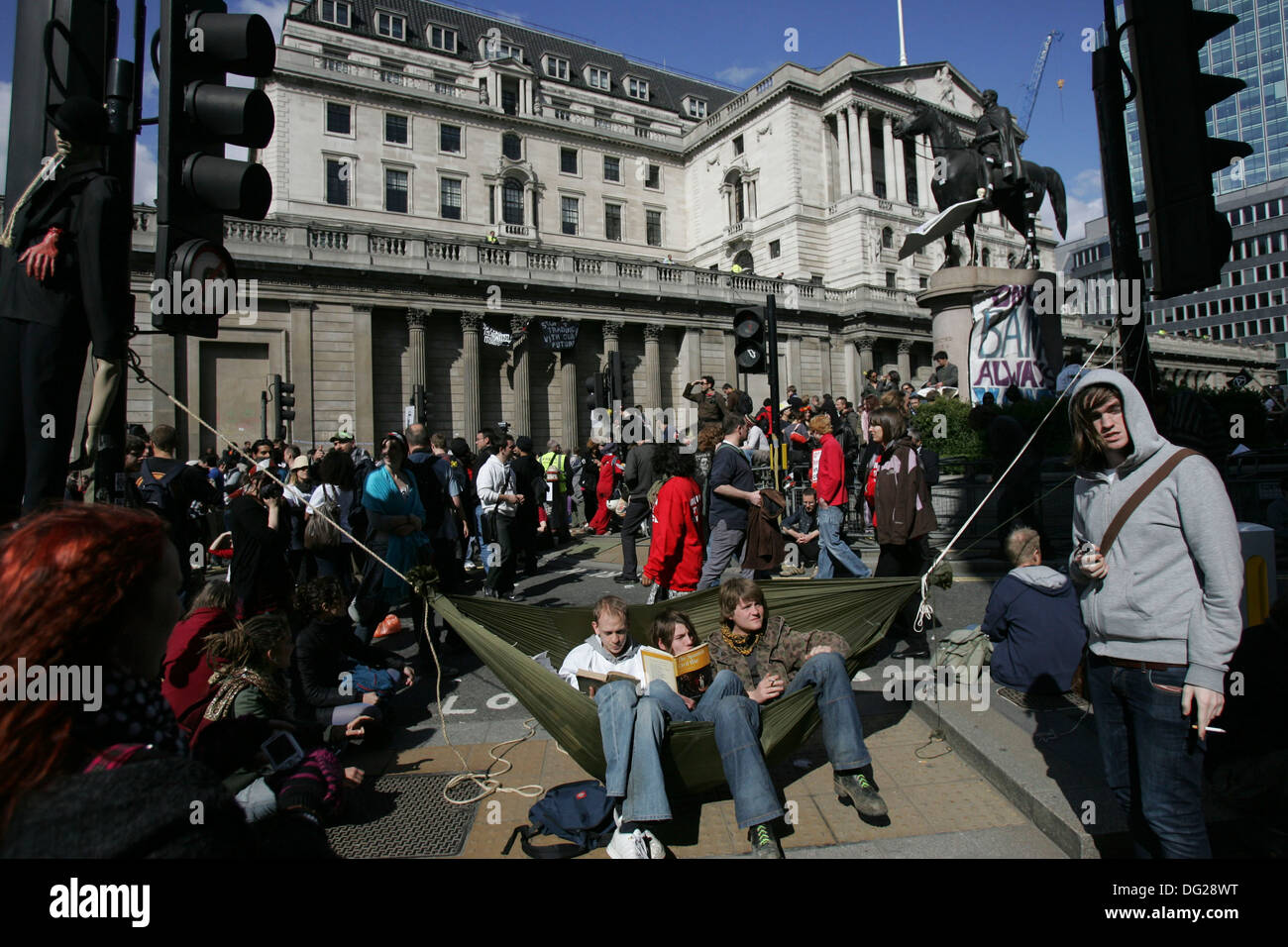 Riot police and  protesters near the Bank of England in central London following a mass rally as the G20 summit begins, on April - Stock Image