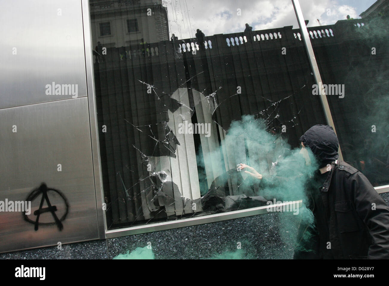 Protesters smashed the Royal Bank of Scotland (RBS) office windows branch near the Bank of England on April 1, 2009. - Stock Image