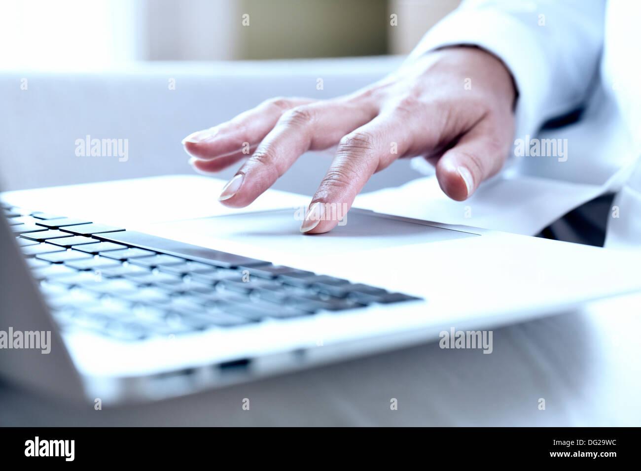 woman computer finger keyboard desk - Stock Image