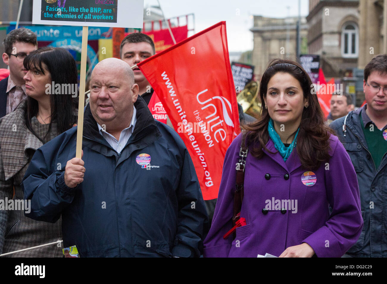 Hundreds of demonstrators accompanied by political figures including the Mayor of Liverpool Joe Anderson (left) and Shadow Minister for Public Health Luciana Berger (right) joined a march through Liverpool city centre on Saturday, October 12, 2013 which focused on the tagline 'Celebrating Not Dividing'. The demonstration which was called by Unite the Union, was held to spread the message that far-right British National Party (BNP) leader Nick Griffin must be defeated at the European Parliament elections in 2014. - Stock Image