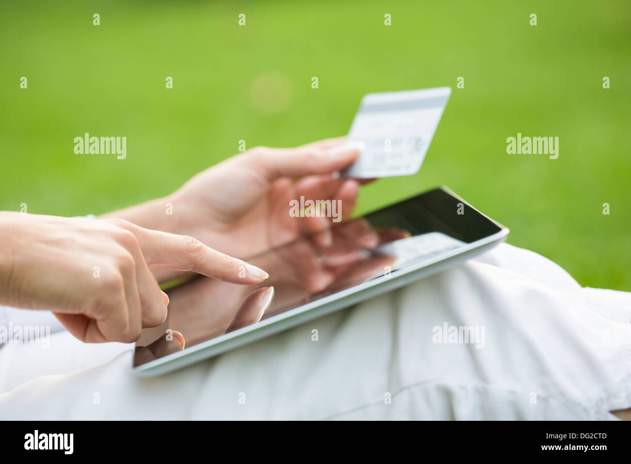 Female outdoor computer finger web plastic card Stock Photo
