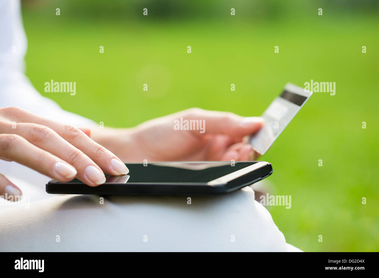 Female outdoor computer finger web plastic card Stock Photo